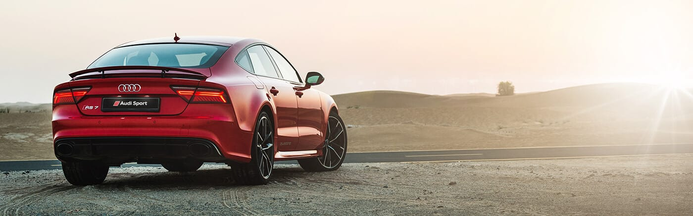 RS7__sport_performance_sportback_audi_red_rear_sunset_1400x438.jpg